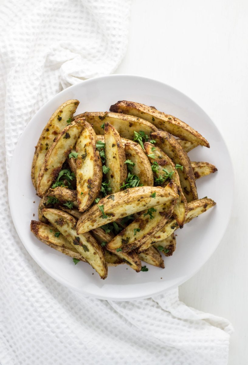 Vegan Cheesy Herb Potato Wedges