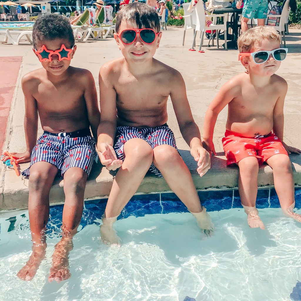Boys sitting at the pool - Summer of Yes