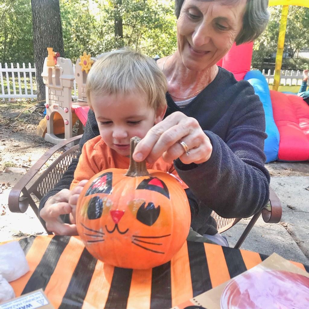 Pumpkin Decorating: Porter and my mom decorating pumpkins