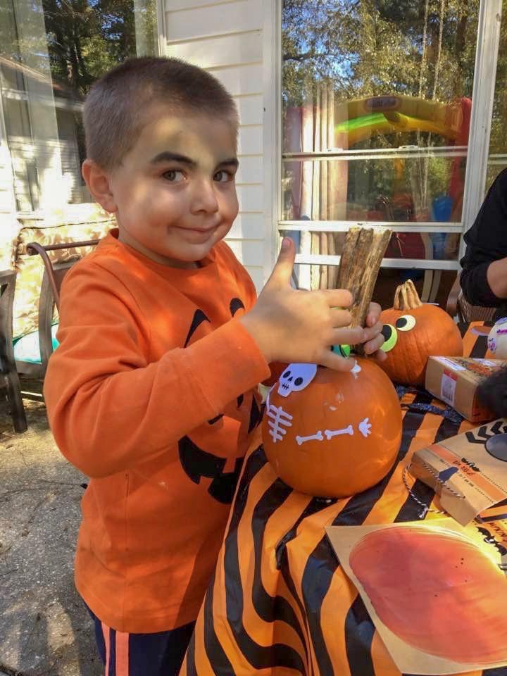Peyton decorating pumpkins