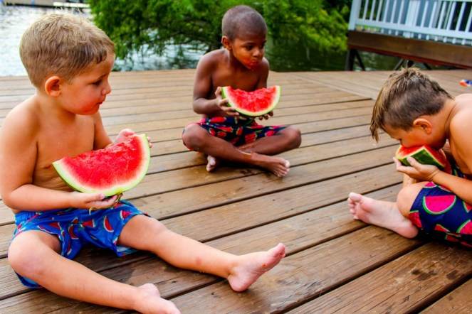 Kids eating watermelon on the deck on Caney Lake