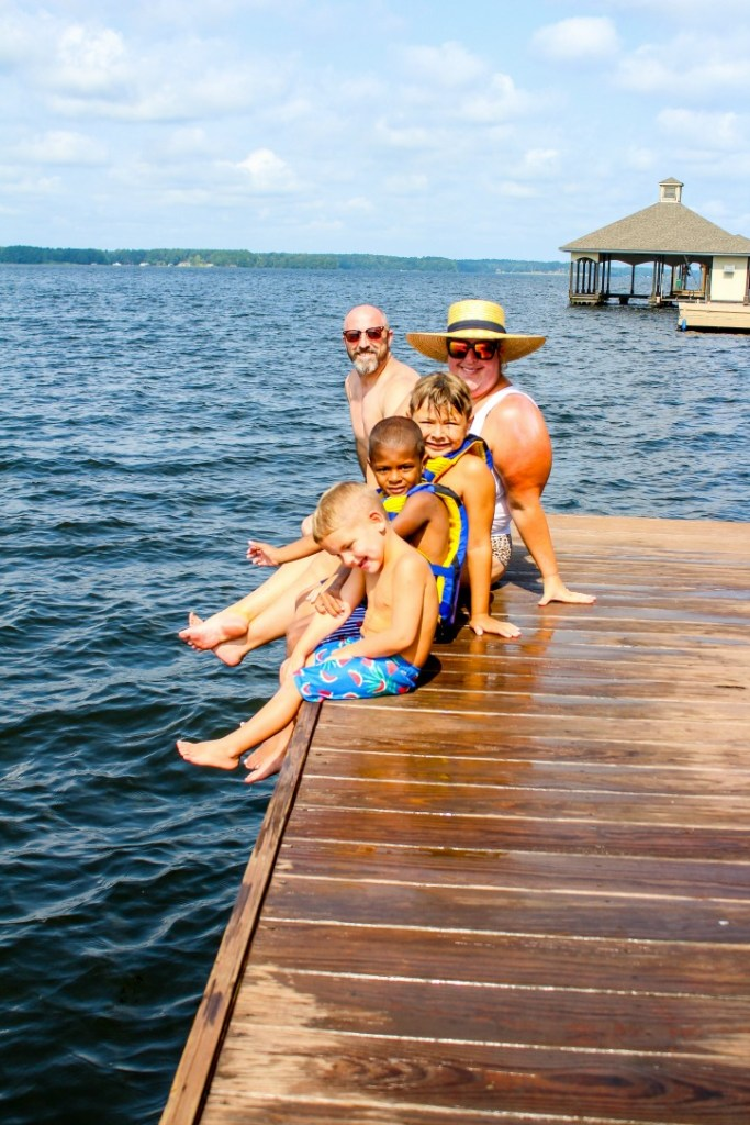 Our family on the deck of the Lily Pad on Caney Lake
