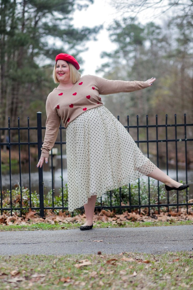 Tiffany in Heart sweater and polka dot skirt