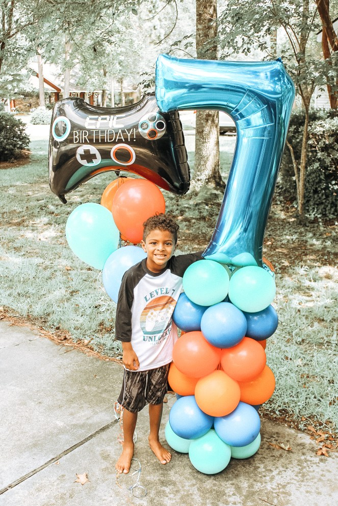 Birthday boys with balloon columns