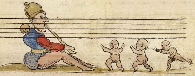 Garbus przygrywający dzieciom do tańca.