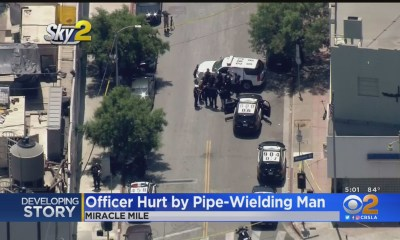 Man Armed With Pipe Injures Officer During Incident On Miracle Mile