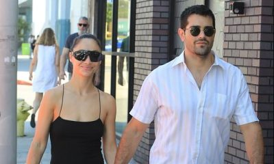 Jesse Metcalfe and Cara Santana hold hands on the street after grabbing an al fresco lunch and running errands in West Hollywood