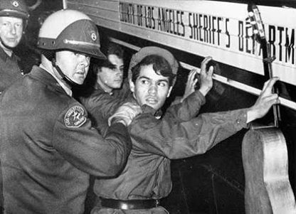 Peter Fonda being arrested at the Sunset Strip Curfew Riot in 1966.
