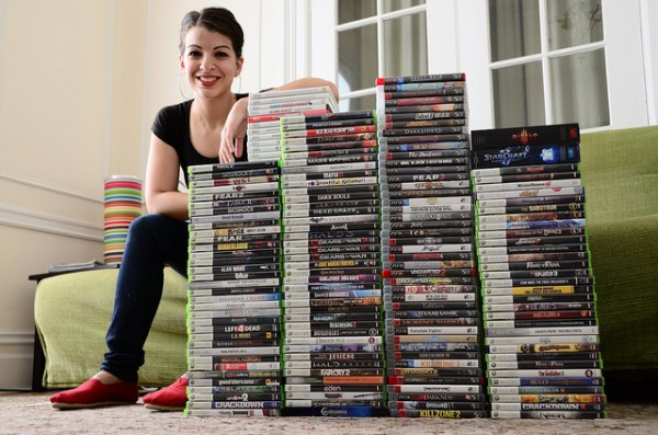 Sneaky Anita Sarekeesian, trying to hide behind a stack of video games.