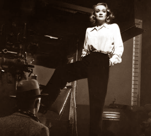 Marlene Dietrich oppressing man with her trousers.