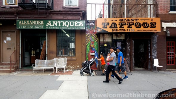Alexander Antiques, one of several antique shops that have been in the area for well over a decade and Giant Tattoos next door.