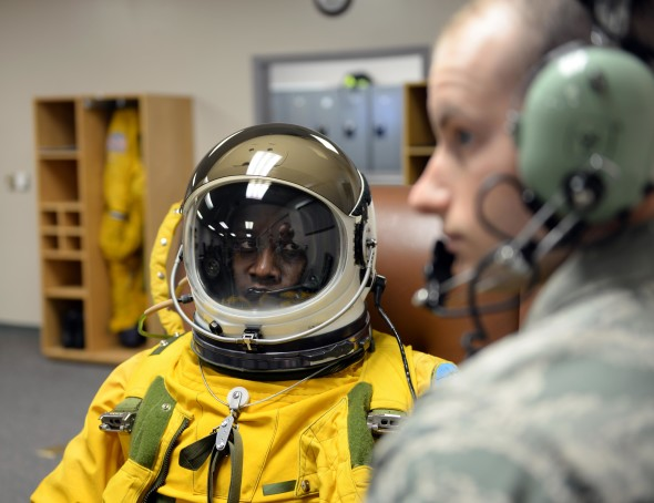 Lt. Col. Merryl Tengesdal receives a maintenance check on her full pressure suit by Senior Airman Garret McNeely in preparation to take flight in a U-2 Feb. 9, 2015 at Beale Air Force Base, Calif. Tengesdal is the 9th Reconnaissance Wing inspector general and a U-2 pilot. McNeely is a 9th Physiological Support Squadron aerospace physiology technician. (U.S. Air Force photo/Senior Airman Bobby Cummings)