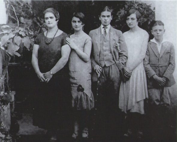 Frida Kahlo in drag, with sisters Adriana and Christina and cousins Carmen and Carlos Verasa, photographed by Guillermo Kahlo, 1926.