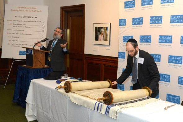 At Calvary Hospital's kick-off event for the restoration of a historic Torah Scroll, Rabbi Moshe Druin from Sofer On Site educated the audience about the Torah restoration process. / Via Daily News