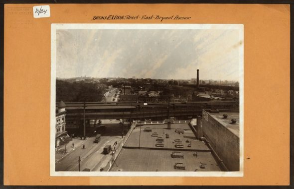 """East 180th Street on Bryant Avenue. The El you see, however, is NOT East 180th Street on Morris Park on the 2/5 train but the old Bronx Park Terminal of the 7th Avenue IRT on Boston Road. In the distance you can see the East 180th Street station which is now the 2/5 line.(1926) Irma and Paul Milstein Division of United States History, Local History and Genealogy, The New York Public Library. """"Bronx: 180th Street (East) - Bryant Avenue"""" The New York Public Library Digital Collections. 1926."""