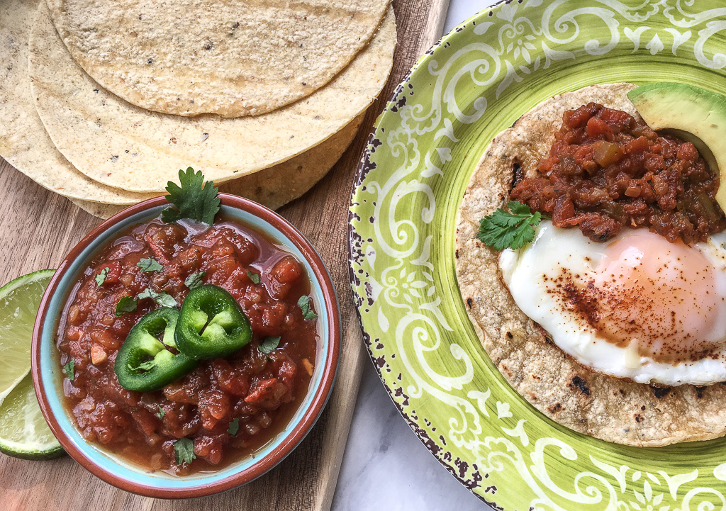 Sheila's Fresh Spicy Salsa served in a bowl and on a plate.