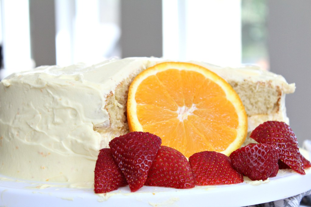 Sheila's Orange Vanilla Cake on a cake stand.