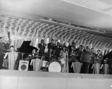 1941 - Ella Fitzgerald Orchestra including Beverly Peer, John Trueheart, Taft Jordan, Bill Beason, Mouse Randolph, Dick Vance, Francis Williams, Elmer Williams, George Matthews, Earl Hardy, John Rocks McConnell, Eddie Barefield, Willard Brown, Lonnie Simmons. Source - Frank Driggs Collection, Magnum Photos (reference PAR60336).