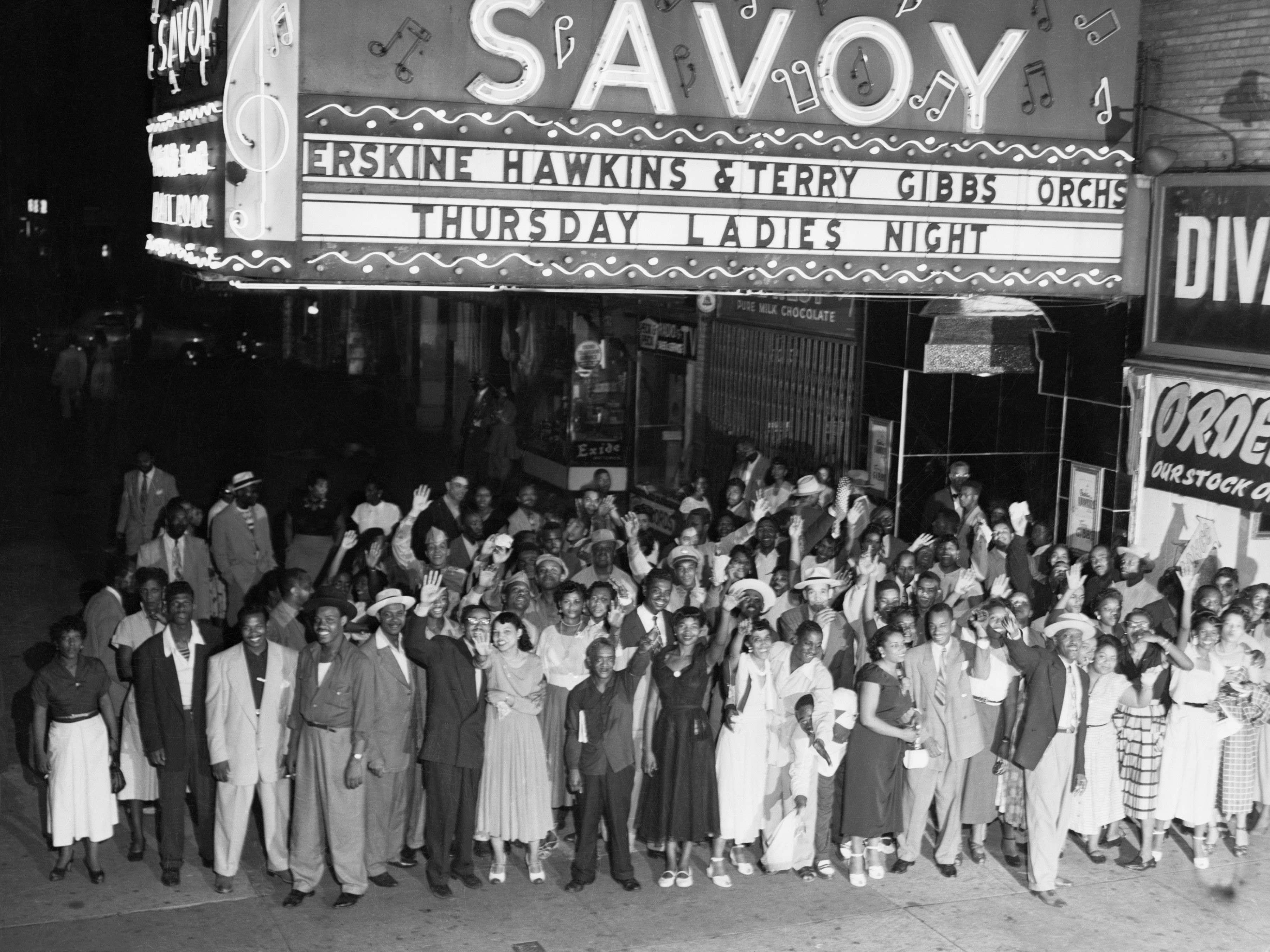 1952 – Crowd outside the Savoy in 1952, marquee advertising Erskine  Hawkins & Terry Gibbs orchestras. Source: Bettmann Collection, Getty Images 514880892.