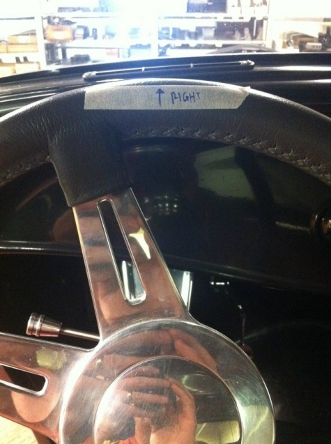 Rotate the steering wheel all the way in one direction, then mark the top. I used masking tape so I didn't have to write on the leather.