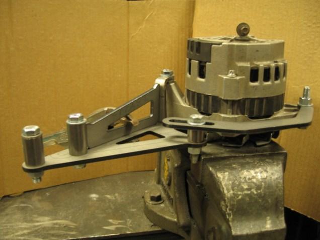 Our long alternator bracket bring assembled using an alternator as a fixture.