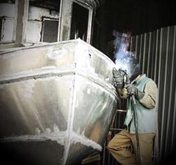 Man welding an aluminum boat