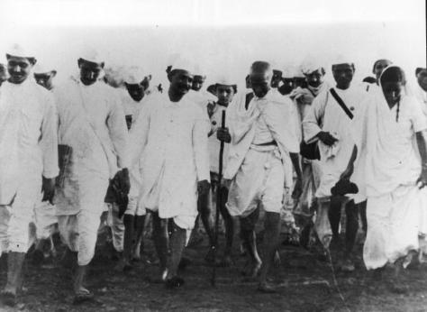 Mahatma Gandhi (1869 - 1948) (foreground, second right with walking staff) and his followers during the Salt March protests, India, March or April 1930. The march, orgainzed by Gandhi, was a 25-day, 241-mile walk across India designed to protest taxes on salt levied by the British on the Indian people. (Photo by Mansell/The LIFE Picture Collection/Getty Images)