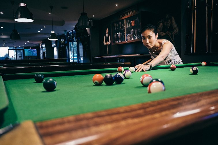 Jeehe playing her first game of pool
