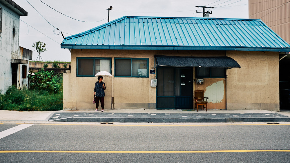 A granny waits for the bus in Buyeo