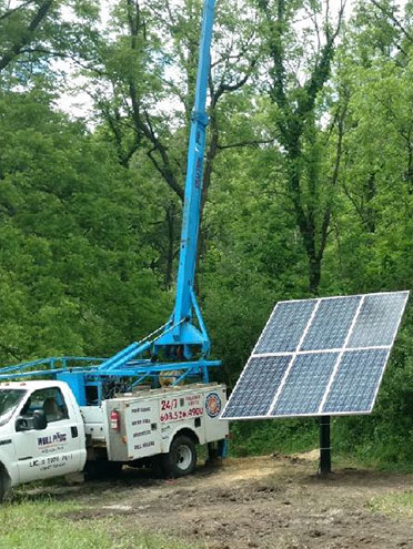 Well Pros truck and solar panel
