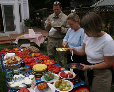 Todd, Ingrid, and Mumble compare tomatoes