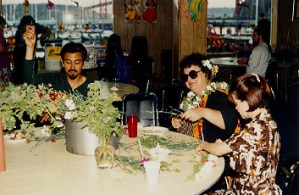 """""""... (latiny) had a splendid '50s tapa cloth print Hawaiian dress on. A strapless number with """"bones"""" in the bodice so it stands up by itself even if you're not wearin' it. And a matching little bolero jacket. I was deeply impressed."""" -- (peoples)"""