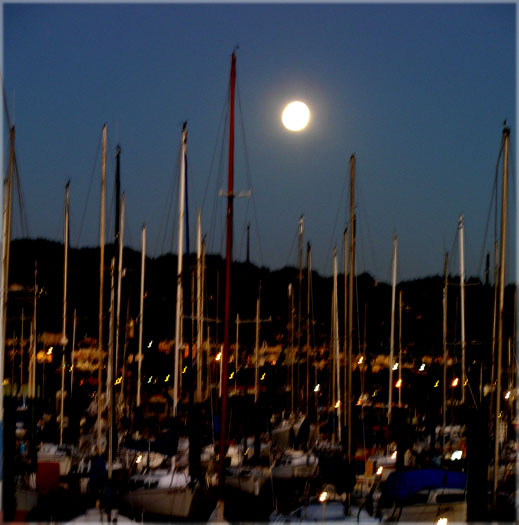 and a full moon rising in the east