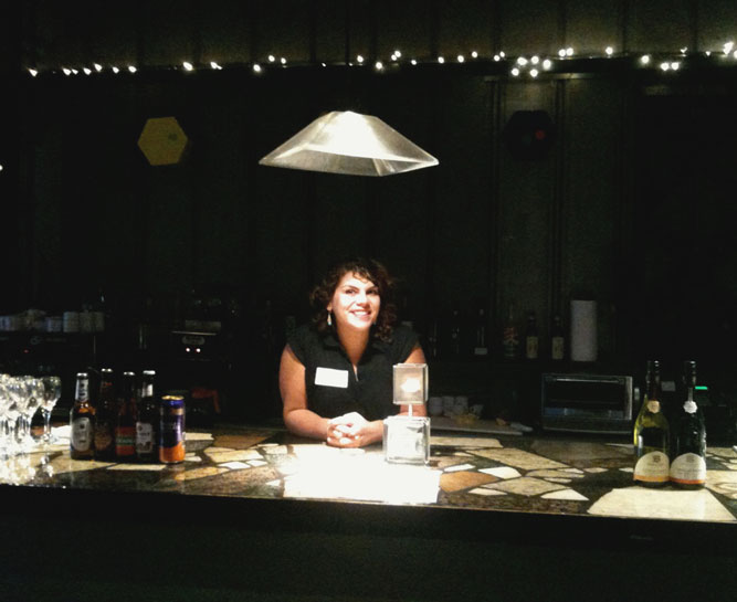 """Triptych's bartender Ellie gamely dons an """"Ellie NOTW"""" name tag."""