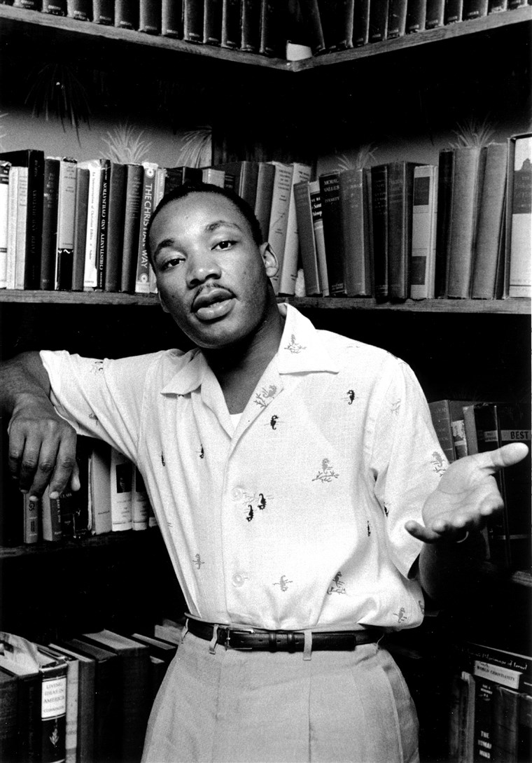 Martin Luther King Jr in front of bookcase