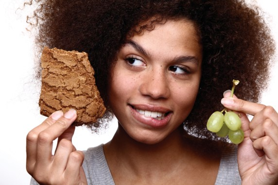 Afro lady choosing between two kinds of food