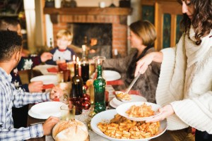 Beautiful family sitting at the table enjoying the christmas meal