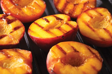Fresh peaches on grill macro. Horizontal