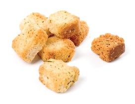 Small pile of herb croutons on a white background