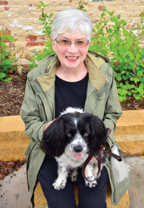 Jude Heimel and hearing alert service dog, Lacey