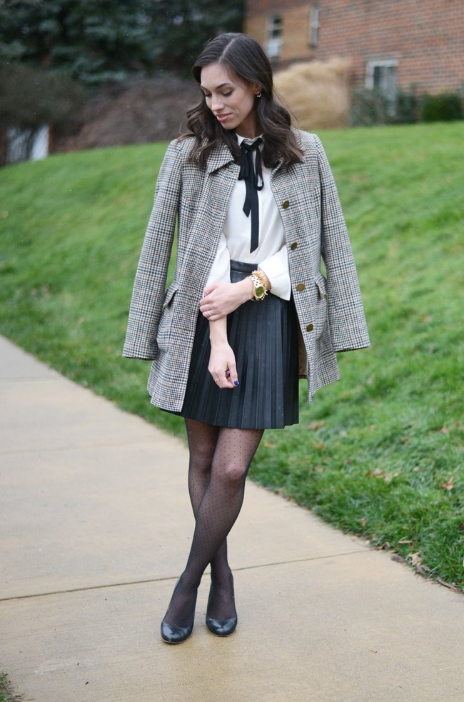 Wellesley & King - a style blog   A classic outfit for work or weekend, a pleated leather skirt and bow tie blouse with a classic plaid overcoat. Click for more style every day style inspiration that YOU can wear!