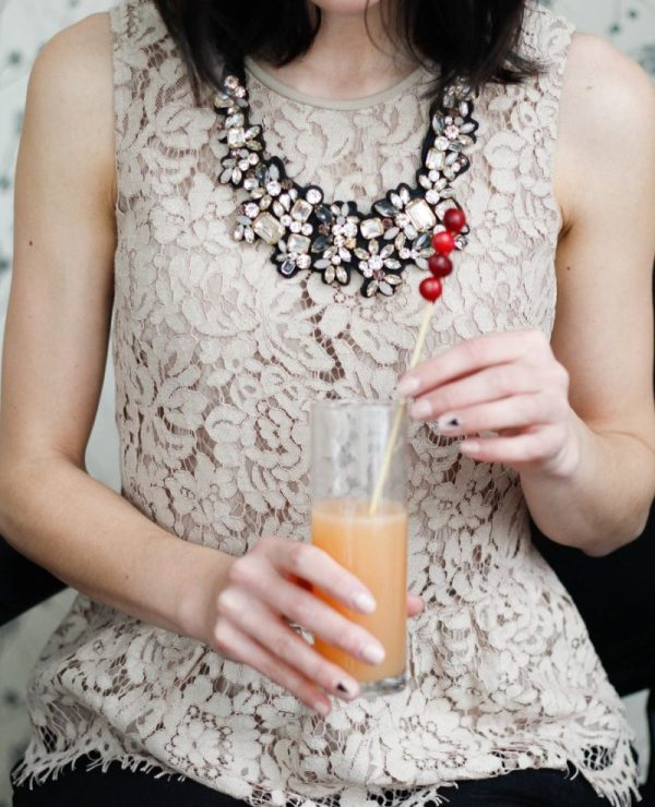 statement necklace peplum lace top | Feminine winter brunch recipes and outfits featured by top Pittsburgh life and style blog, Wellesley and King
