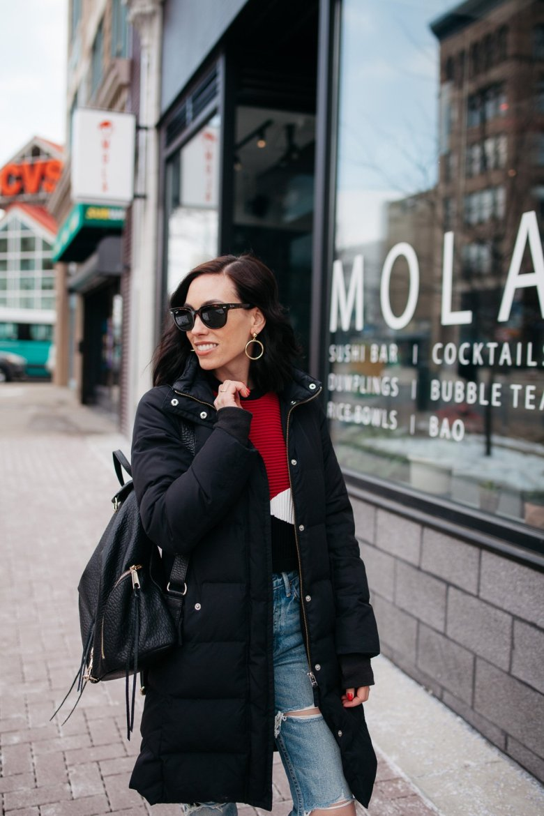 Top US fashion blogger, Wellesley & King, styles a crop sweater and distressed jeans for a chic casual outfit: crop sweater outfit, distressed jeans outfit, converse sneakers outfit, chic leather backpack