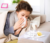 depositphotos_16276245-Flu-or-Cold.-Sneezing-Woman-Sick-Blowing-Nose[1]