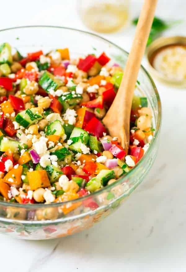 A bowl of chickpea salad with feta
