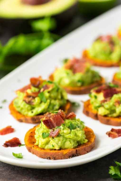 platter of baked Sweet Potato Bites topped with Bacon and Avocado