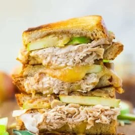 Turkey Cheddar Apple Grilled Cheese Sandwich. The best flavors of fall! Melty cheddar, sweet apple butter, granny smith apples, and healthy turkey make an amazing sweet and savory flavor combination that tastes like fall! Healthy comfort food that's perfect for fast lunches and easy family meals. Recipe at wellplated.com