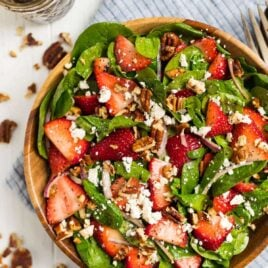 The best ever Spinach Strawberry Salad with Balsamic Poppyseed Dressing, pecans, and feta or goat cheese.