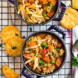 Two bowls of hamburger soup with vegetables