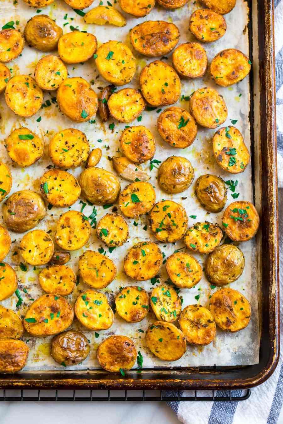 Sliced potatoes on a sheet pan